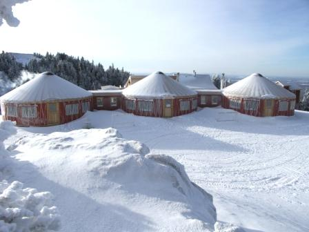 Mt. Orford Ski Resort in Quebec, Canada uses covered walkways to join their three yurts..